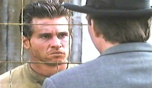 The Man Who Broke 1,000 Chains #5 - Val Kilmer as Robert Elliot Burns and the back of x as his brother Victor