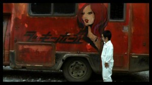 9 Souls #3 - Mame Yamada as Hidemi Shiratori in front of the reasonably recognisable red van
