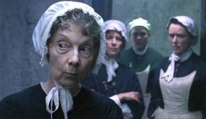 Affinity #4 - Anna Massey as the prison Governor, Miss Haxby in front of her matrons