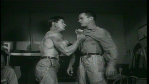 Big House, U.S.A. - Benny Kelly (Charles Bronson) muscles Jerry 'The Iceman' Barker (Ralph Meeker)