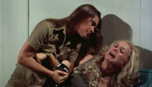 Black Mama, White Mama #2 - Warden Logan (Laurie Burton) puts a wrist lock on lover Matron Densmore (Lynn Borden)