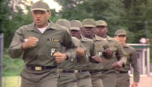 Cadence #2 - inmates doing the Stockade Shuffle. Frm the front, Larry Fishburne as Stokes, x, x, x, Harry Stewart as Crane and Charlie Sheen as Bean