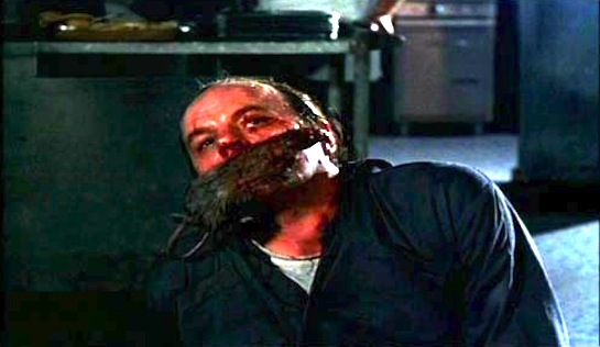 Chaindance - Michael Ironside as JT Blake - after having a rat inserted in his mouth