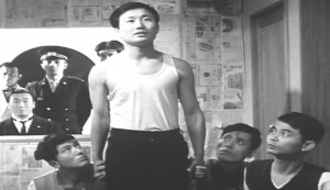 Death by Hanging #2 - Yun-Do Yun as R, with guards playing his sisters. Hosei Tomatsu as the Public Prosecutor is seated at the rear