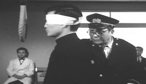 Death by Hanging #3 - Yun-Do Yun faces the gallows a second time, assisted by Fumio Watanabe as the Education Officer. Rokko Toura as the doctor is in the background.