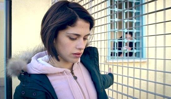 Fiore - Daphne Scoccia as Daphne Bonori, with Josh in his cell in the background