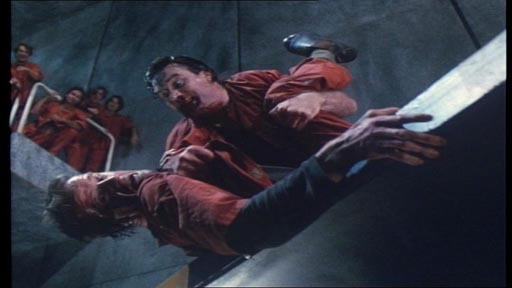 Fortress - Maddox (Vernon Wells) has the upper hand in a fight with John Brennick (Christopher Lambert)