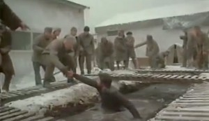Gulag #4 - David Keith as Mickey Almon in the open sewer, reaching out to Malcolm McDowell as 'The Englishman' Kenneth Barrington