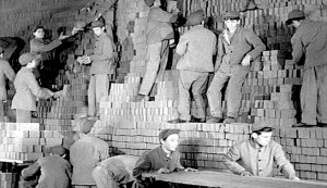 Hell's House #4 - The brickworks. Shorty (Junior Coughlin) is pushing the trolley and Jimmy (Junior Dirkin) is standing above him, hands on hips.