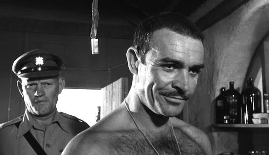 The Hill - Sean Connery as Joe Roberts, with Harry Andrew as Regimental Sergeant Major Wilson in the background