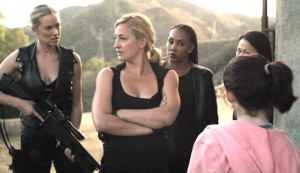 Mercenaries #2 - Kristanna Loken as Kat Morgan, Zoë Bell as Cassandra Clay, Vivica A Fox as Raven, Nicole Bilderback (part-obscured) as Mei-lin Fong, and (in foreground) Alexis Raich as Lexi