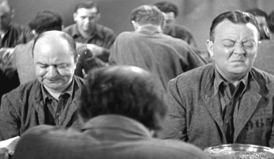 Millionaires in Prison - Chester Clute as Sidney Keats and Raymond Walburn as Bruce Vander.. unable to conceal their reaction to the food