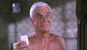 Naked Gun 33? - The Final Insult - Leslie Nielsen as Frank Drebin, having picked up the soap (in an iron chastity belt)