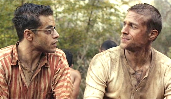 Papillon - Rami Malek as Louis Dega and Charlie Hunnam as Henri 'Papillon' Charrière