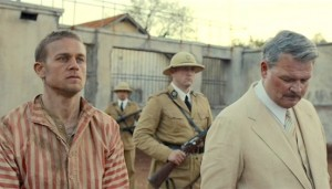 Papillon #4 - Charlie Hunnam as Henri 'Papillon' Charrière and Yorick van Wageningen as Warden Barrot