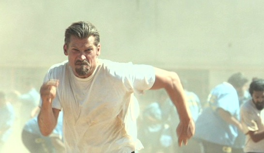 Shot Caller - Nikolaj Coster-Waldau as Jacob 'Money' Harlon, joining a riot
