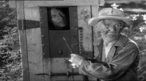 Sullivan's Travels #3 - Joel McCrea as John L Sullivan in the hot box, and Jimmy Conlin as the Trusty