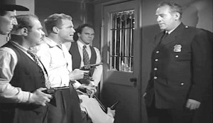 Train to Alcatraz #2 - Doug Forbes (Don 'Red' Barry) holds Guard Grady (Roy Barcroft) at gunpoint