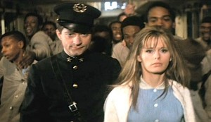 The Traveling Executioner #2 - James Sloyan as Malcolm Piquant escorting Mariana Hill as Gundred Herzallerliebst through the men's prison to her cell