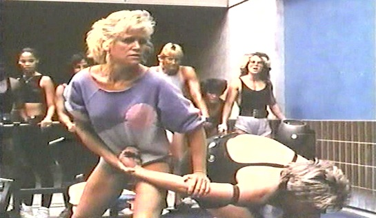 Vendetta - Karen Chase as Laurie Collins, with a wrist lock on Kay Butler (Sandy Martin)