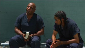 The Wrath of Cain #3 - Ving Rhames as Miles 'Cain' Skinner, with Bible, and Nipsey Hussle as his son, Ricky